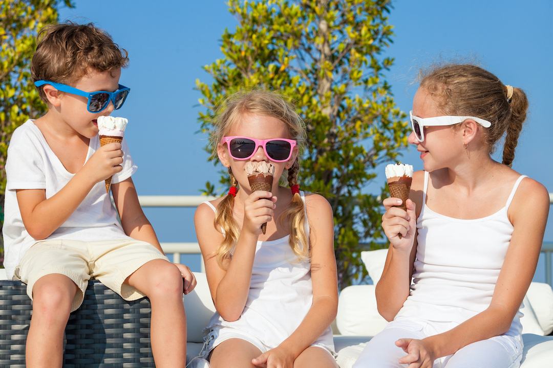 img-three-happy-children-eating-ice-cream-near-swimmin